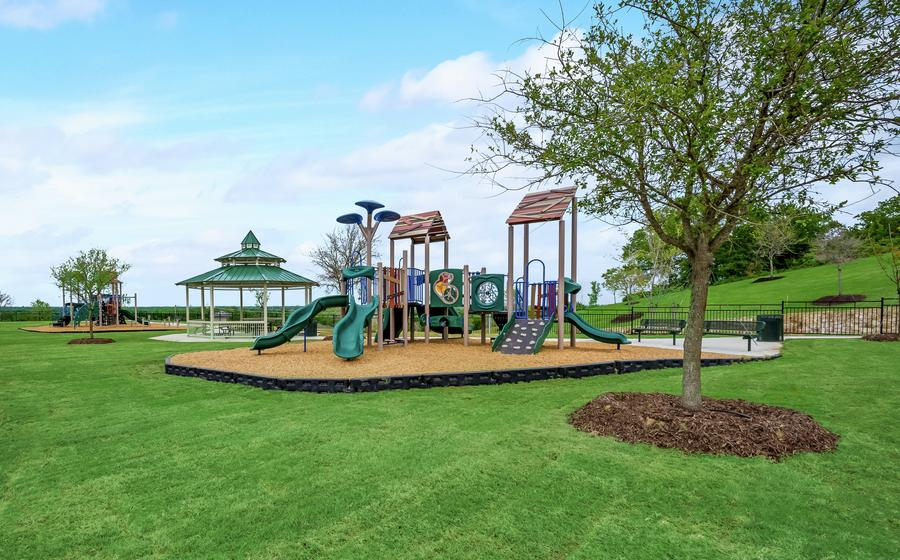 Overview of the park with large play structure and picnic pavilion.