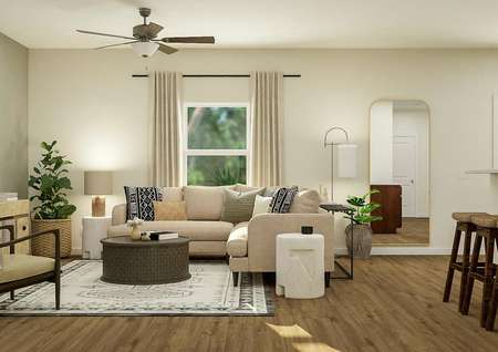 Rendering of   living room with window and ceiling fan, decorated with a tan sectional   couch, round coffee table, accent chair and media center.