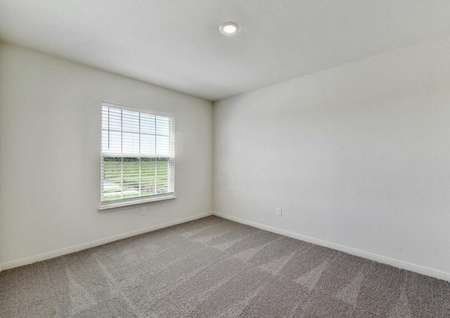 Frio dining room featuring carpet, ceiling light and window with blinds.