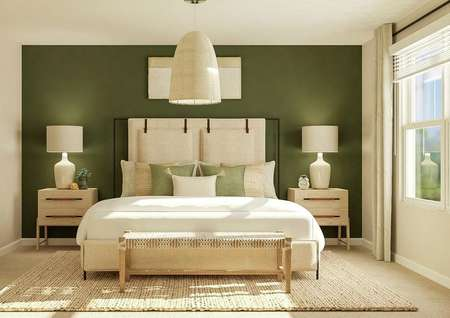 Rendering of a spacious master bedroom   with a large window, carpeted flooring, two tan walls and a green accent   wall. The room is furnished with a large bed, a bench at the end of the bed,   two nightstands and a rug.