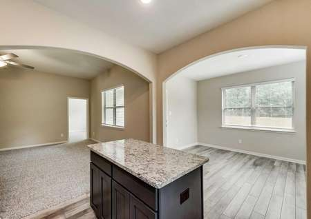 Erie kitchen with granite island, wood-style floors, and recessed lights