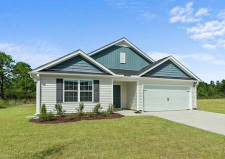 Burton single-family house with two-tone paint finish, green grass, and extended driveway