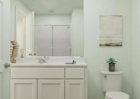 Rendering of a full bath with a white   cabinet vanity and toilet. A shower is visible in the mirror's reflection.