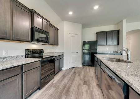 Topeka plan's upgraded kitchen with new all black appliances.