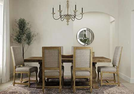 Rendering of the Maple dining room holding a large wooden dining table with six chairs around it. A rug sits on the wood style flooring.