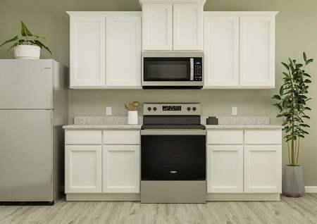 Rendering of the kitchen area with   stainless steel apliances and large countertop.