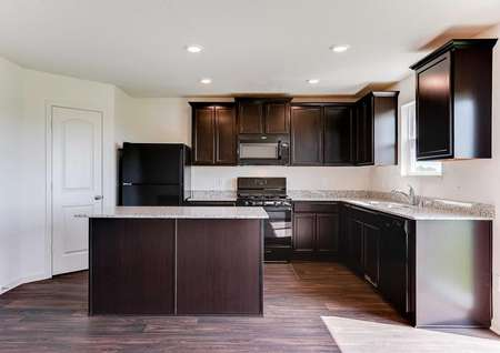 Nicollet kitchen with black appliances, brown cabinets, and plenty of counter space