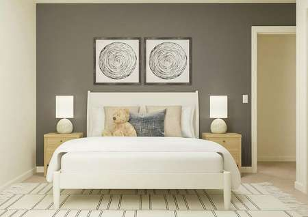 Rendering of a spacious secondary bedroom   with a white bed and light wood nightstands against a gray accent wall. The   carpeted flooring is covered by a black and white rug.