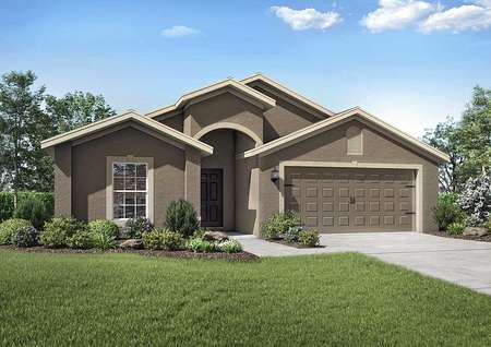 Exterior view of the Estero floor plan model with a two-car garage and a beautifully landscaped front yard.