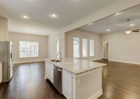 Fairview kitchen with white color granite countertops, stainless steel appliances, and white cabinetry