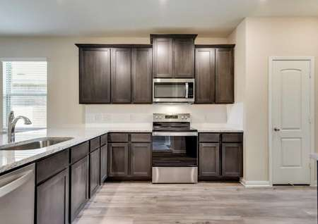Maple kitchen with ceramic flooring, custom cabinetry, and stainless steel appliances