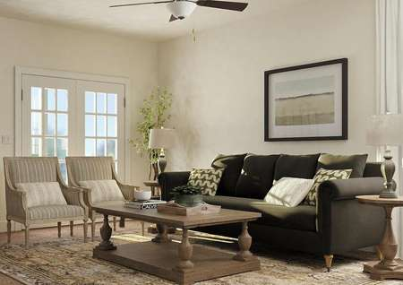 Rendering of the Maple living room which is decorated with a large couch, two side tables, two armchairs and a large rectangular coffee table.