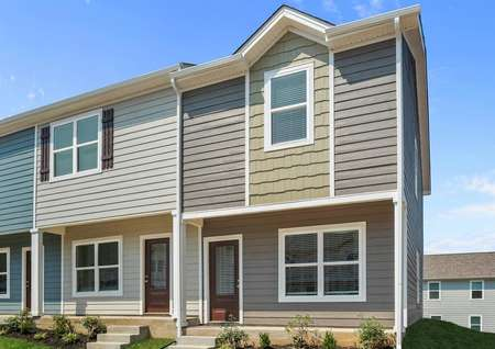 The Birch plan has gray siding accented with tan shake siding.