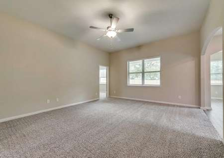 The family room has soaring ceilings and great natural light.