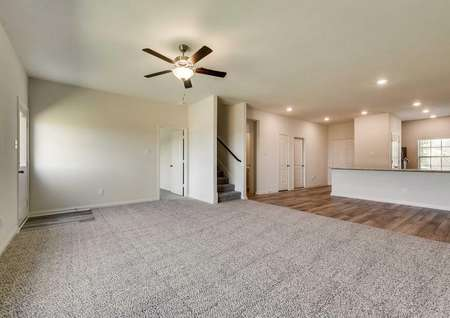 The family room is open to the dining room and kitchen in this layout.
