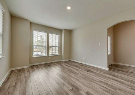 Ontario front room with large white-frame windows, wood-look flooring and ceiling light