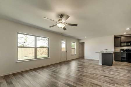 Rio Grande finished great room with overhead fan, tile floors, and backyard access door