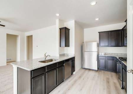 Beautiful kitchen with espresso wood cabinets and stainless steel appliances