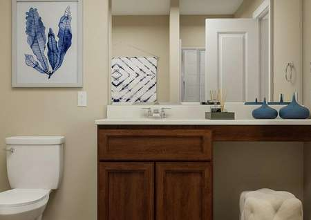 Rendering of bathroom with toilet and   vanity with brown cabinetry