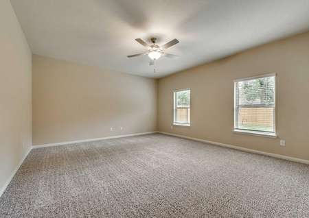 Ozark large living room with two windows, ceiling fan with light kit and carpet