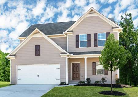 Single family, two story Chatuge floor plan with two-car garage and front yard landscaping