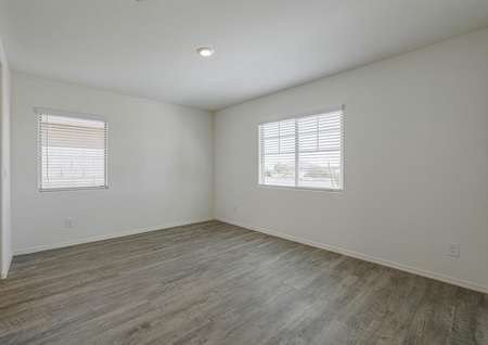 Formal dining room with wood-style floors and access to the entry way and kitchen.