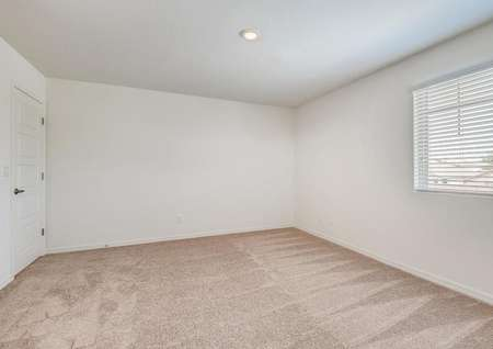 Large bedroom featuring recessed lighting, a closet and a window that lets in natural light.