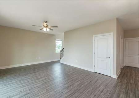 Spacious family room with luxury vinyl plank flooring and plenty of natural light.