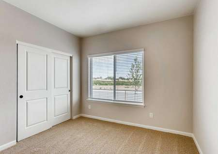 San Juan bedroom with grey walls with white trim, sliding closet doors, and window with blinds