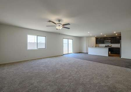 Spacious family room with an open-concept allowing a view of the stunning kitchen.