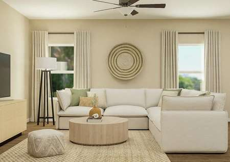 Rendering of the living room with ceiling   fan with light kit, two windows, a cream sectional couch and large round   coffee table.
