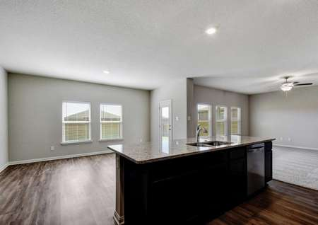 Shelby single family house kitchen with granite island, dining room with hardwood floors, and family room with carpeting