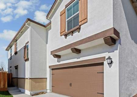 Gorgeous stucco home with window shutters.