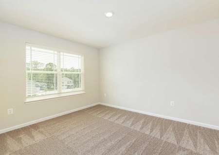 The Mid Atlantic Conway showing another view of second carpeted bedroom with faux wood blinds on the window.