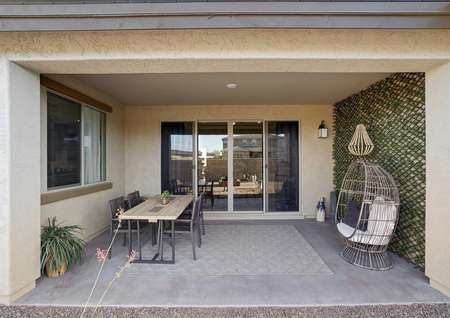 Mead backyard covered patio with furniture, concrete floor, and sliding glass door