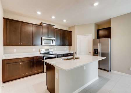 The Santa Maria model home's spacious kitchen. Quartz countertops, stainless steel appliances, tile flooring, upgraded cabinetry and recessed living