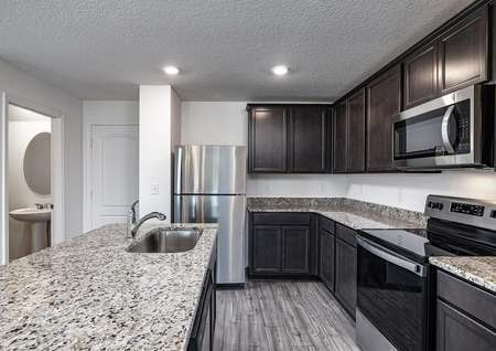 Spacious granite countertops and brand-new kitchen appliances in the heart of the home.