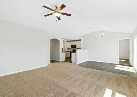 Alamance great room with brown carpet, wood flooring, and off white walls