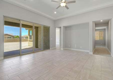 Bartlett family room with double-wide sliding patio doors, TV nook, and ceiling fan/light