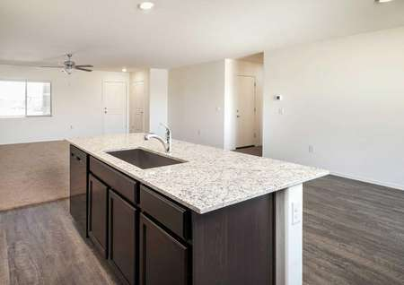 The Luna floorplan shows a kitchen with a granite bar and a view into the living room.