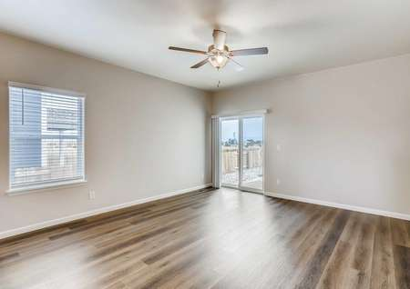 Arapaho family room with overhead light/fan, wood flooring, and off white walls with white trim