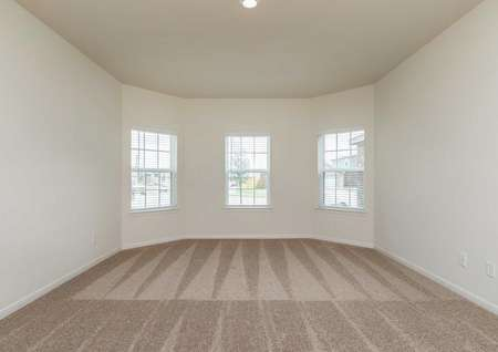Cypress front room with multiple windows, carpeted flooring, and overhead recessed light