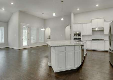 Bradley kitchen with white cabinetry, dark brown ceramic floors, and light color granite