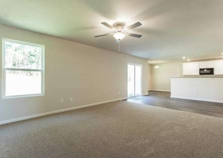 Hartford great room with carpeted family room, tiles kitchen and dining area, and ceiling fan