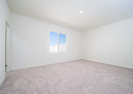 Balboa bedroom with soft carpets, recessed lights, and white trim and walls
