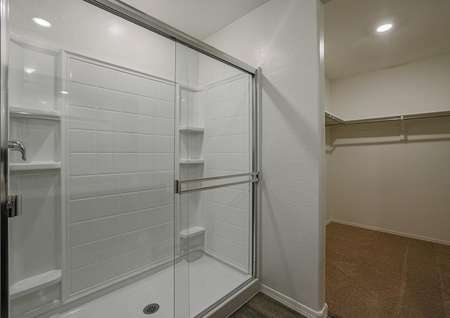 Stunning master shower with sliding doors in the attached master bathroom.