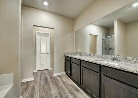 Oakmont floor plan's master bathroom with granite countertops and two sinks.