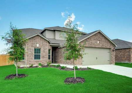Cypress house plan exterior with lush landscaping, brick finish façade, and wood picket fence