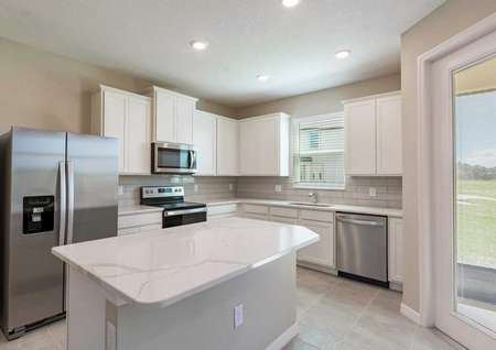 A kitchen with quartz countertops, recessed lighting and 42