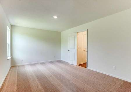 Aitkin bedroom with can light, brown carpets, and white on white walls